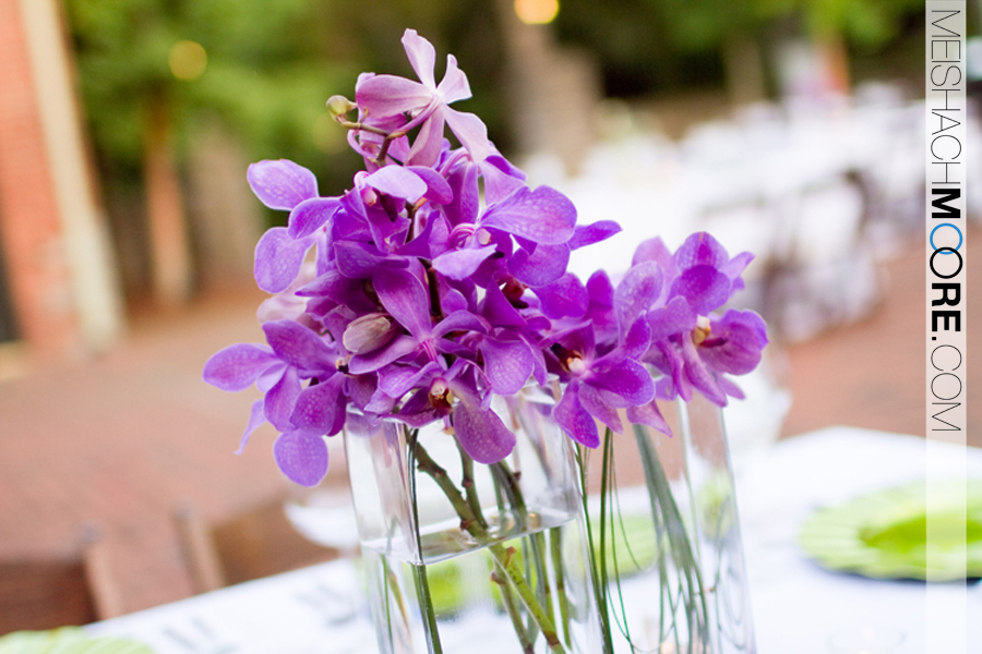 The centerpieces were a mix of purple vanda orchids and green goddess calla