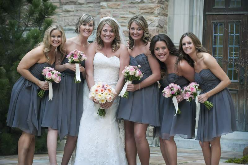 A bride and her maids pose with their bouquets