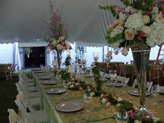 Tall silver vases and candles for wedding centerpiece