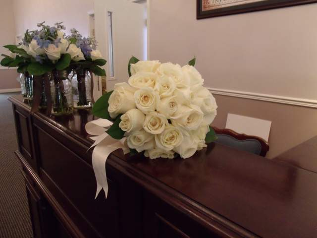 Bride's bouquet of white roses and lemon leaf