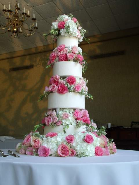 Flower covered wedding cake