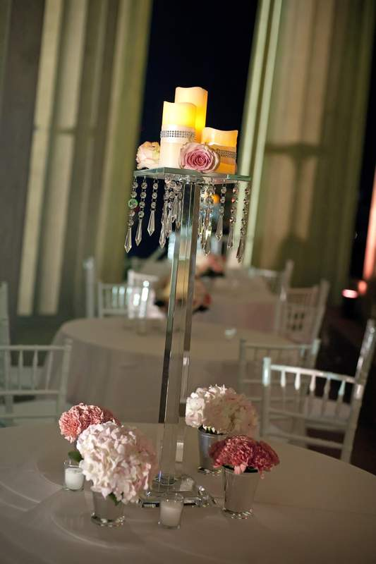 Candlescape on crystal pedestal as wedding centerpiece
